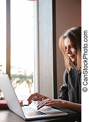 Attractive young woman using laptop computer. - Image of...