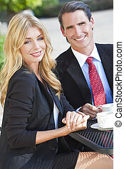 Beautiful Woman & Handsome Man Couple Drinking Coffee At Cafe