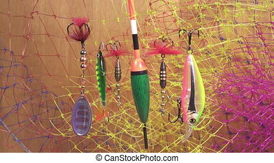 float and baits on a fishing net background,