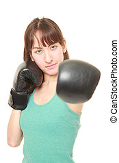 female boxer throwing a left jab - portrait of young female...