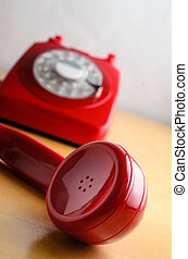 Retro Red Telephone with Receiver Off The Hook - Angled shot...