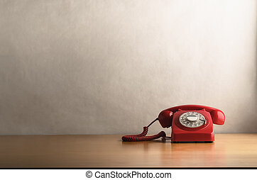 Retro Red Telephone on Light Wood Veneer Desk - Eye level...