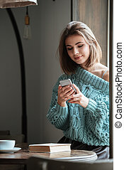 Incredible young woman chatting by her phone. - Photo of...