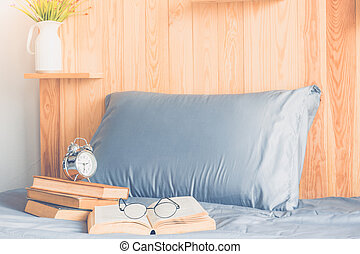 book and bed - Old books with glasses and alarm clock on bed