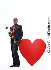 African man holding rose, present for Valentine Day - Young...