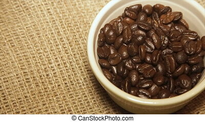 Serve coffee beans in rotation.Full hd video