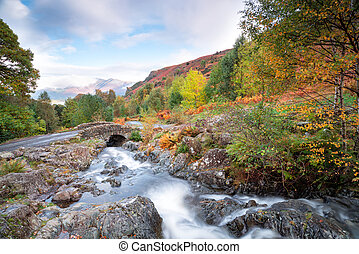 Ashness Bridge - Water flowing under Ashness Bridge near...