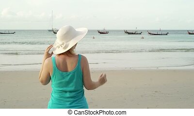 Young blonde woman on the beach