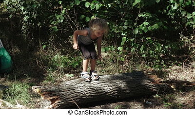 Girl jumping from logs - Dirty girl refugee have white bread