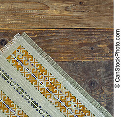 Wooden table covered with tablecloth cloth cut
