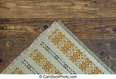 Wooden table covered with tablecloth cloth