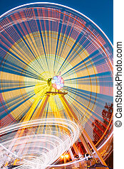Motion Blurred Of High Speed Rotating Attraction Amusement...