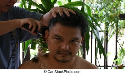 Asian man hair cut - Asian man use equipment clippers hair...