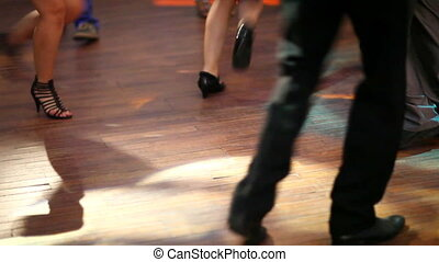 People dancing on disco. Legs closeup view.