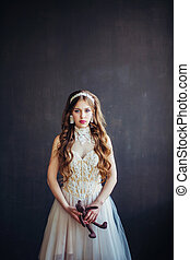 Fashion photo of sad girl wearing wedding dress - Fashion...