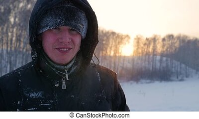 the guy laughing merrily in the winter, at sunset. snow winter landscape. outdoors