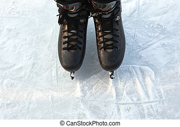 Legs in Ice Skates - Two legs in skates on ice, winter...