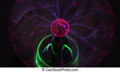 Colorful plasma ball is on the table