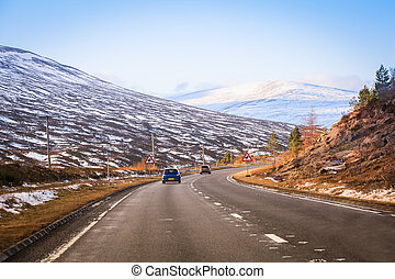 Car Travel - traffic on a road through Scotland