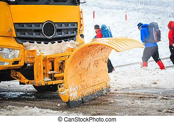 Snow Plough - close up snow plough shovel in action
