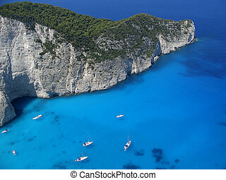 Yachts in blue sea new peninsula in Navagio bay