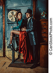 Pretty flirting couple dressed in vintage costumes on the...