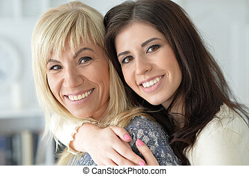 portrait of smiling mother and daughter, close up