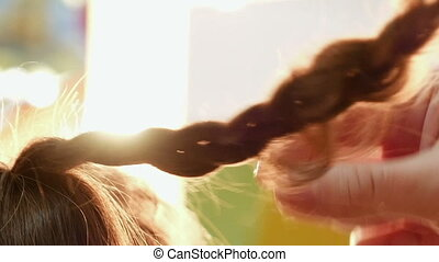 Female model getting her hair dressed before an event....
