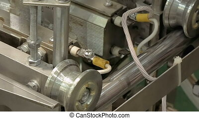 Factory packing machine with pipes and rolls - Factory...