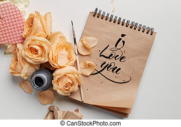 Roses and heart with notebook
