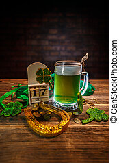 Happy St Patricks Day concept with horseshoe, green beer and...