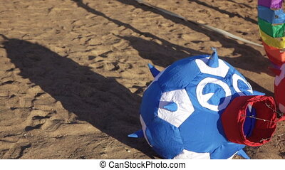 Balloon lying on the sand - On sand is Air Balloon in the...