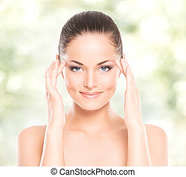 Portrait of young, beautiful and healthy woman: over spring and summer background. Healthcare, spa, makeup and face lifting concept.