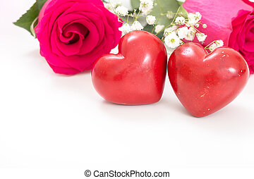 Two red hearts with bouquet of red roses, on white with copy-space.