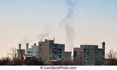 Power stations in a city bringing heavy pollution