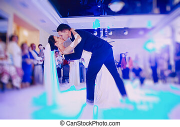 first wedding dance - bride and groom dancing in the...