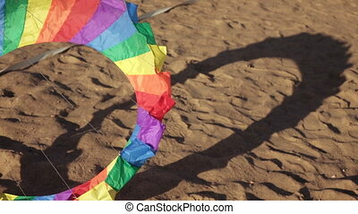 Floating multi-colored parachute