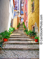 Narrow european street with cobblestone steps and old houses, Portugal