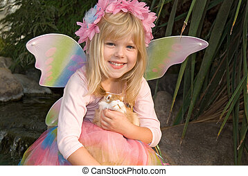 fairy child - Happy little girl with fairy wings in garden