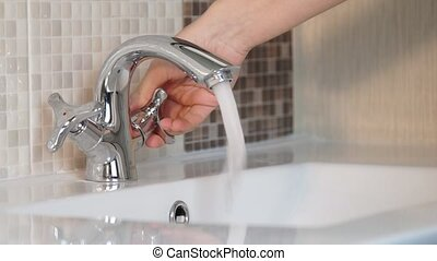 Male Washing and Drying Her Hands.