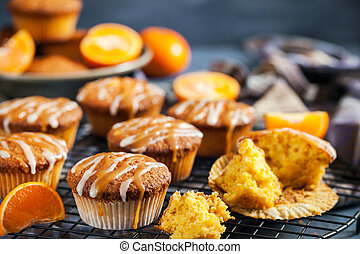 Carrot tangerine cupcakes with glaze and caramel topping -...