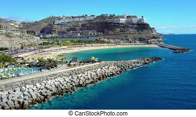 Flying over the beautiful Amadores beach at Gran Canaria -...