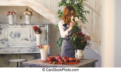Chef woman preparing flowers, fruits and vegetables for cooking and making fruit bouquet