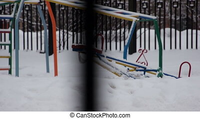 Children s playground in winter with no one at it - Winter...