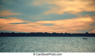 Boat on river or lake at dawn - Boat silhouette on river or...