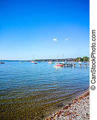 Bavarian Ammersee with boats on the lake as background