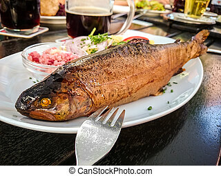 Smoked trout whole with horseradish and garnish