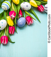 Tulips with colorful Easter eggs - Red and yellow tulips...