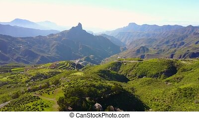 Flying over lush landscape and mountains at Gran Canaria -...