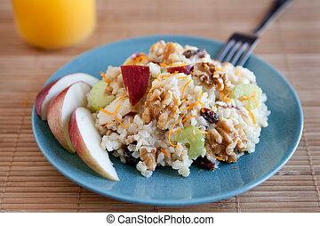 waldorff salad - one plate of apple walnut salad with...